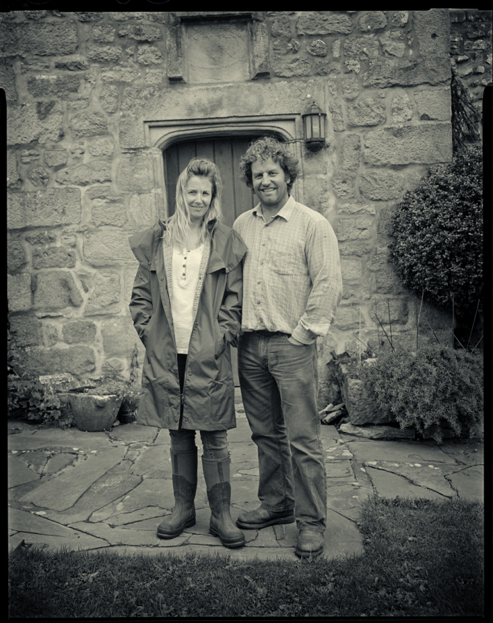 Leigh Weston and Neil Heseltine outside of their farm in Malham
