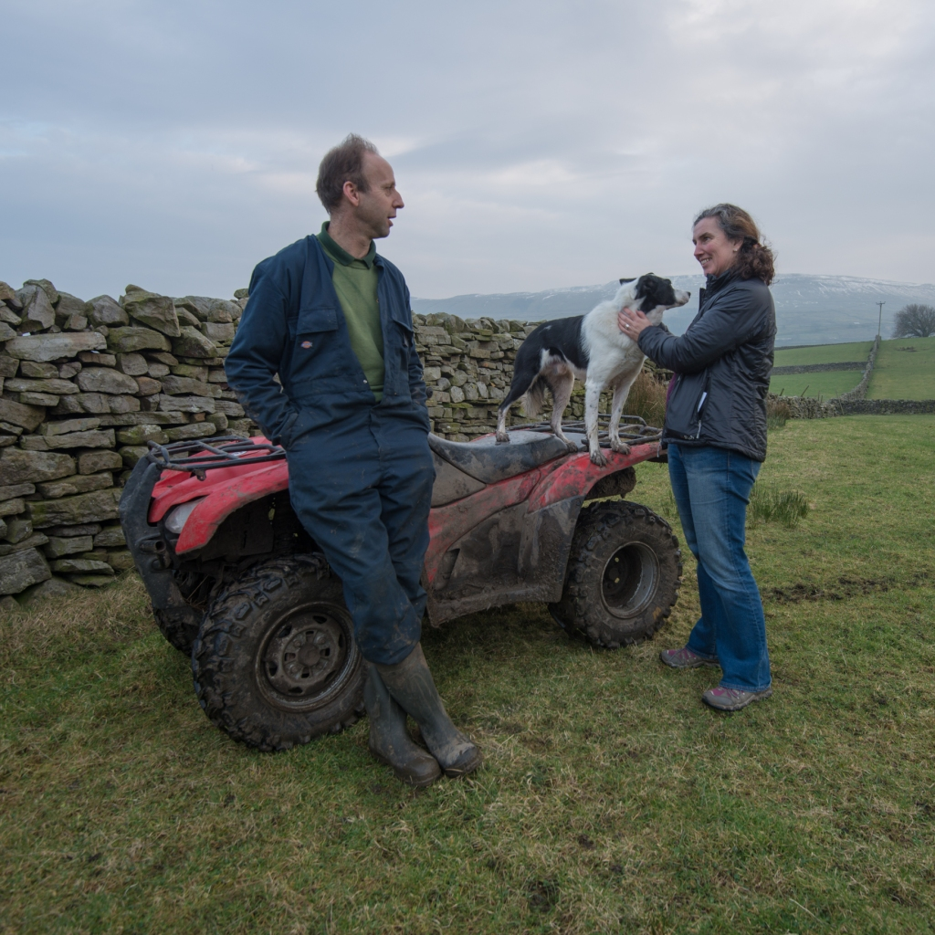 Harriet getting friendly with Bob the dog whilst chatting to Ant Heseltine on his farmland on the edge of Hawes.
