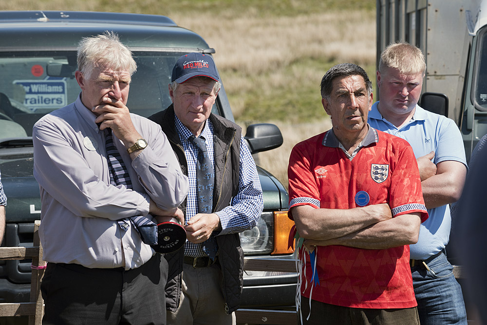 Raymond Calvert and others looking on Tan Hill