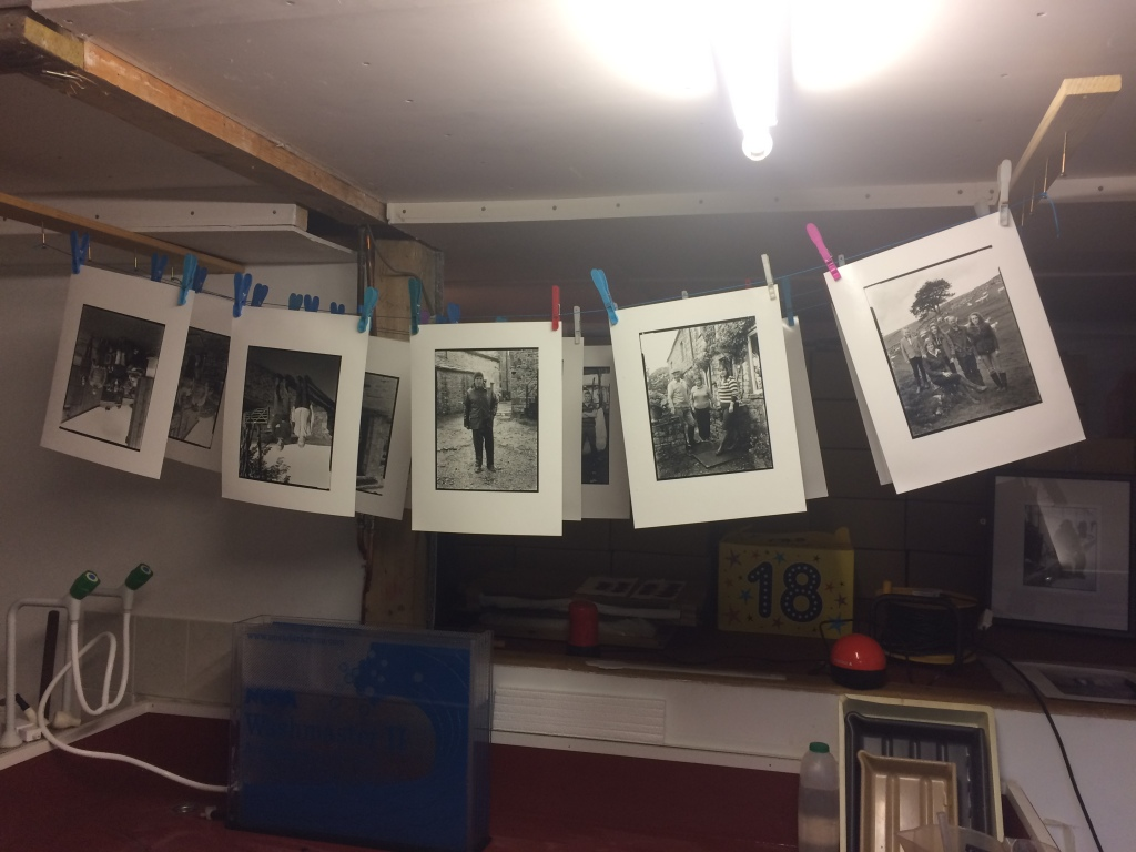 A few of the black and white portraits of the farmers drying in Rob's darkroom.