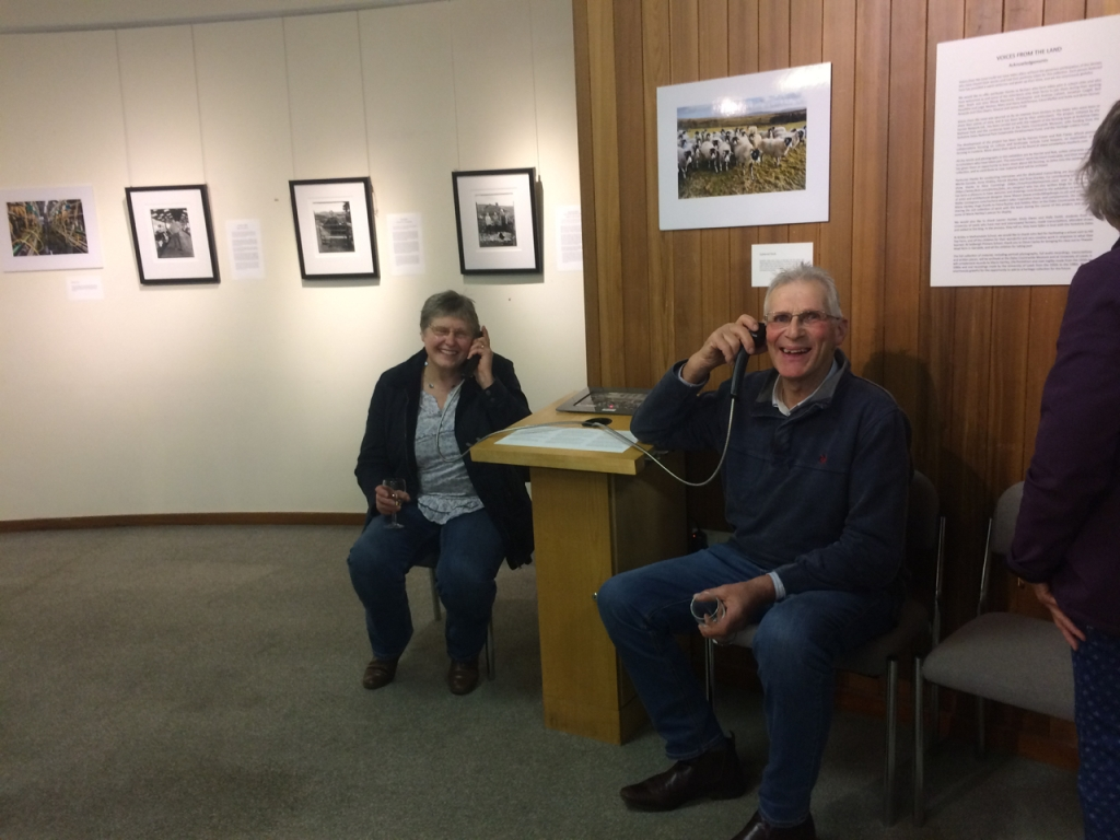 Harry and Mary Hutchinson listening to some of the recorded interviews at the Voices from the Land Exhibition, Hawes